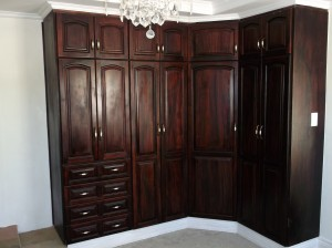 Corner mahogany built in cupboards with drawers