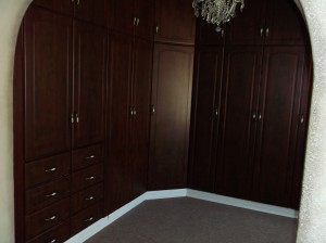 Brown wrap built in cupboard with drawers