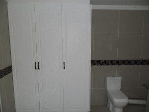 Tall cabinet in bathroom