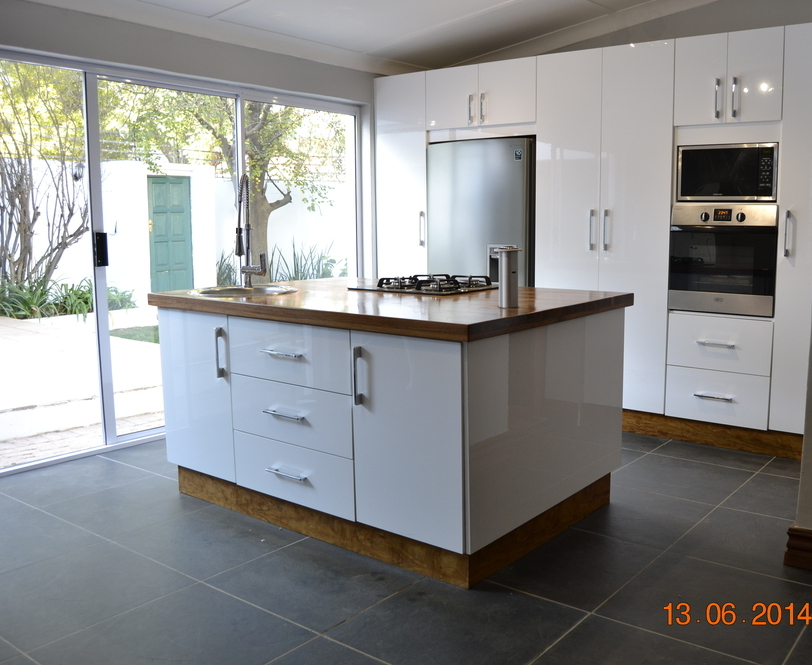 White high gloss acrylic kitchen nico 39 s kitchens for South african kitchen cabinets
