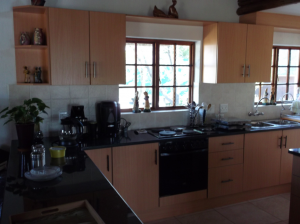 Brown-orange melamine kitchen cupboards Pretoria