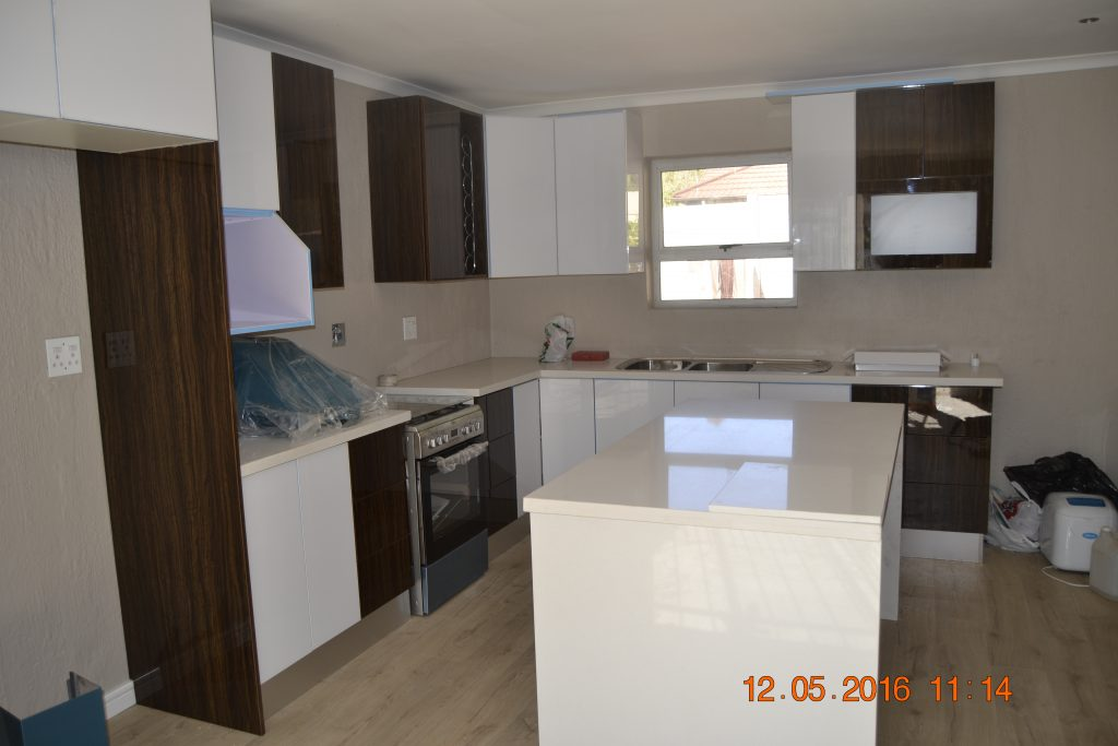 Two tone high gloss kitchen units
