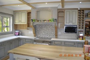 Green kitchen with white tops